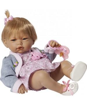 Muñeca recién nacida, vestido flores y chaqueta gris.