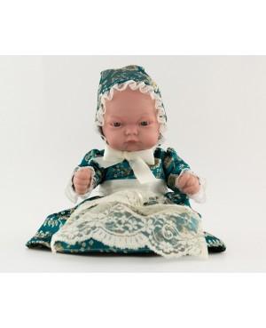 Muñeca bebé vestida con traje regional. Vestido verde botella y capota. 25 cms.