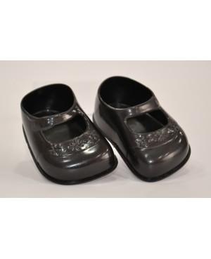 Zapatos negros para muñeca.