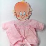 traje de lana con gorro rosa